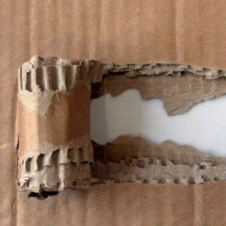 Torn cardboard brown