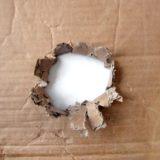 Torn cardboard hole brown