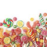 Perempuan untuk permen makanan permen warna-warni